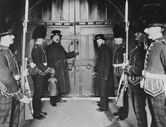 The ancient ceremony of locking the Tower gates at night, the Tower of London. 1898