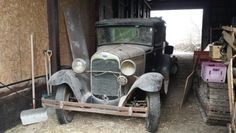 Old 1932 Ford Model A sitting in a barn in rural Iowa