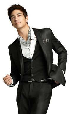 Dennis Oh...black three piece suit with shirt and neck scarf