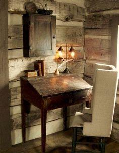 Slant top desk in a corner.