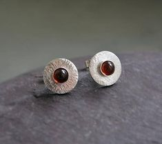 Small sterling silver stud earrings with garnet. Disc silver
