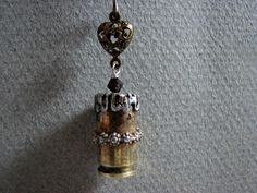Bullet casing soldered with decorative wire and by bijousavvy, $45.00