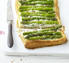 An open puff pastry pie of seasonal greens, mint, chives and parsley with a creamy mascarpone base