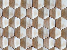 Handmade hexagon ceramic tiles in white and golden brown
