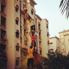'Govindas' form a human pyramid and successfully break the 'handi' (pot of curd) on the occasion of Gokulashtami in Mumbai
