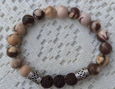 Zebra stone and lava rock aromatherapy beaded bracelet by TwinenWineCreations on Etsy