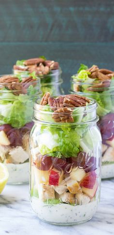 How to make healthy mason jar salads for make-ahead lunches! These CHICKEN SALAD MASON JAR SALADS with pecans and apple have a creamy, no mayo poppy seed dressing! | www.kristineskitchenblog.com