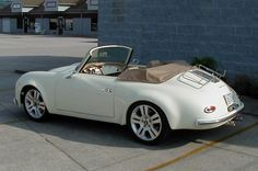 1957 Porsche 356 Speedster. I love the luggage rack but those modern wheels have got to go.