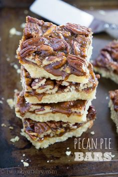 Pecan Pie Bars Recipe ~ YUM... The crust is a delicate buttery layer that reminds me of a shortbread cookie. The topping is filled with caramel lathered pecans, oh so gooey and sweet!