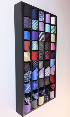 This Tie Display Case neatly organizes up to 50 Ties, Bow Ties, Pocket Squares, Watches and more!  Bring the store display case home with you... customize your own tie display at tiesandcloset.etsy.com