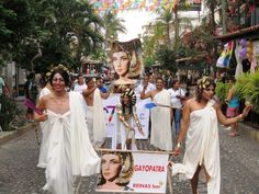 Puerto Vallarta Gay Pride with Parade, Events and Photos. The head of the gay pride parade in Vallarta as it moves up Olas Altas street in Old Town in May 2015 with Reinas (Queens) bar and a novel Gayopatra/Cleopatra ancient motif with togas and all....