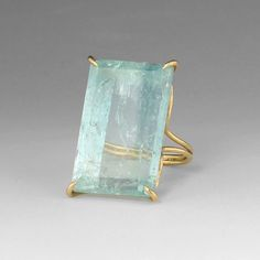 """18k yellow gold, aquamarine ring, size 6. Stone measures 0.5"""" wide and 1"""" long."""