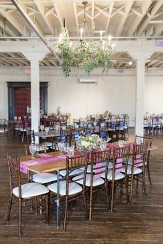 BRIK Venue | Fort Worth | Texas | Industrial | Historic | Warehouse | Wedding | Events | Bride | Groom | Beatbox Portraits | Venus & Co Floral Design | Rio Mambo Catering | HD Liquid Catering | DJ Cale Bessent | The Traveling Photo Booth | BHLDN | Details | Marfa Inspired | Table Decor | Pink Runner | Pink Napkins | Floral | Table Numbers | Wood | Chandelier | Greenery