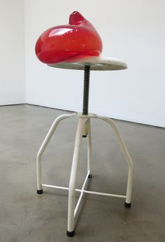 The title of Mona Hatoum's 'Stool III' ignores the drama happening on top of the furniture as a blood-red glass form looks ready to shift weight and crash to the floor. Referred to in other of Hatoum's artwork as cells and looking like internal organs, the precipitously arranged red shape implies an impending crisis. (At Chelsea's Alexander and Bonin through July 24th).Mona Hatoum, Stool III, painted metal and glass, 30 ½ x 16 x 14 ½ in, 2014.