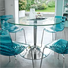 round glass kitchen tables | ... Guides on How to Choose the Best Glass Dining Tables | Sitazine.com