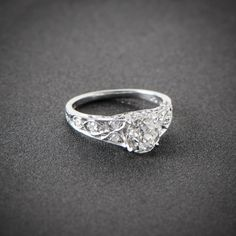 A beautiful Old Mine Cut Diamond Engagement Ring, set in a stunning handmade platinum setting and adorned with filigree and a 1.49ct diamond.