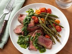 Get Grilled Steak with Green Beans, Tomatoes and Chimichurri Sauce Recipe from Food Network