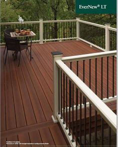 Another deck created by us at DiGiorgi. The white railing is a nice contrast against the dark floor of the deck.
