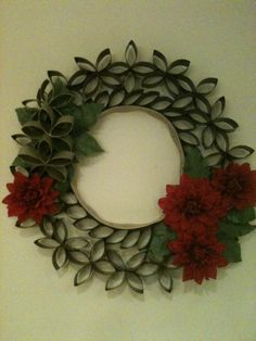 Wreath made of flattened toilet paper cardboard rolls.