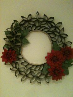 Wreath made of flattened toilet paper cardboard rolls.