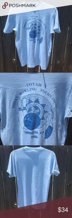 """VTG 1986 TOTAH NEW MEXICO BLUE T-SHIRT SZ M VTG 1986 TOTAH NEW MEXICO BLUE T-SHIRT SZ M- 50/50 SHIRT-ARMPIT TO ARMPIT 18"""" FRONT LENGTH 23"""" SOME SPOTS AT FRONT SEE PICTURE Vintage Tops Tees - Short Sleeve"""