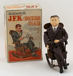 """1963 John F. Kennedy doll by Kamar — When wound up, the toy chair rocks back and forth and plays """"Happy Days Are Here Again"""" (JFK's campaign song)."""