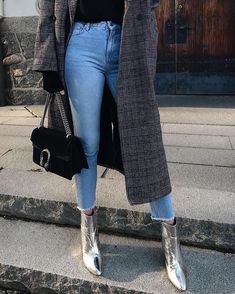 Plaid coat + silver boot.