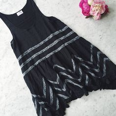 FREE PEOPLE Voile & Lace Trapeze Slip • NWOT free people  voile and lace trapeze slip  black dotted slip dress with lace inset throughout. ruffled hem.   ⠀† xsmall ⠀† black ⠀† 100% rayon ⠀† by free people intimately ⠀† new without tags⠀  host pick!    ⠀5.22.16 › wardrobe refresh  ⠀ disclaimer: ⠀✗ i do not trade ⠀✗ no lowballing ⠀✓  i'm open to reasonable offers ⠀✓  more savings when you bundle Free People Dresses