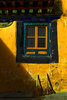 The brilliantly hued colors of Tibet are shown off in this little window ~ photo by Robert Tingley