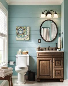 Love the blue painted shiplap and rustic vanity in this farmhouse style bathroom
