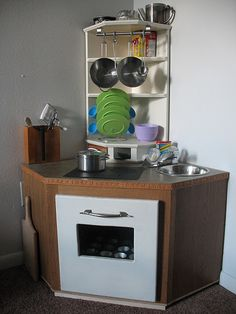 Coolest DIY kids kitchen, ever!  Made for 3 little chefs.