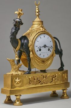 c1820 A Restauration patinated and gilt bronze mantel clock circa 1820, dial signed Mignardet a Paris Estimate  7,000 — 10,000  USD  LOT SOLD. 13,750 USD (Hammer Price with Buyer's Premium