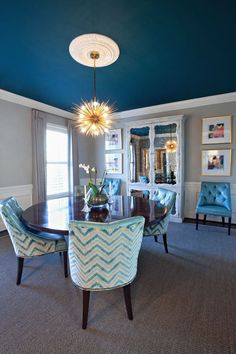 Stunning dining room designed by High Point, NC based design firm of Barbour Spangle! Love the ceiling color - Pratt & Lambert's Whirlpool Blue!  Wall color is Pratt & Lambert Gossamer.  via houseofturquoise.com