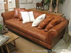 Rolled arm leather sofa with tufted seat available in loveseat, apartment sofa, sofa and chair. Over 1000 fabrics, many cushion options- Country Willow Furniture