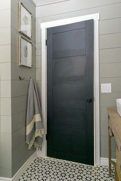Wall color Silt Gray.. door is Dark Kettle Black both Valspar Love the ship lap and simple craftsman door frame