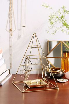 Magical Thinking Pyramid Jewelry Stand by URBAN OUTFITTERS for $24 - might be easy to make if I learn to weld <3