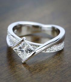 A beautiful Bezel Bridge Princess Cut Diamond Engagement Ring in White Gold! See more of our recently purchased rings by clicking through this Pin!
