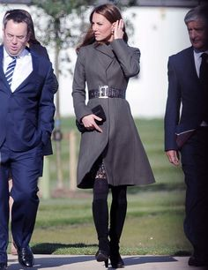 Kate Middleton wears a green Reiss coat at the opening of the Football Assocation's new Centre of Excellence along with the FA's patron, Prince William.