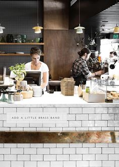 brass banding in white subway tile - coco kelley in the details