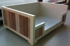 Wooden / pallet Dog bed. Like the contrast between the wood colors and the painted white.