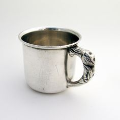 "American sterling silver baby cup with rabbit handle by Saart Brothers Company. Monogrammed ""W.J.K.""."