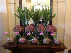 Lobby display. Made with hydrangea, calla lilies, moluccella and willow branches.