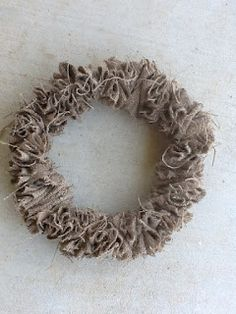 The Weekend Country Girl made this weath from old burlap and a wire hanger.  Super Simple