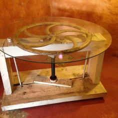 Large paper press - repurposed to a table with glass top!