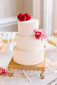 Simple 3 tier white and pink wedding cake