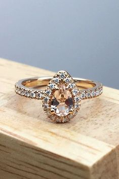 30 Morganite Engagement Rings We Are Obsessed With ❤️ morganite engagement rings pear cut rose gold pave band ❤️ See more: http://www.weddingforward.com/morganite-engagement-rings/ #weddingforward #wedding #bride #engagementrings #morganiteengagementrings