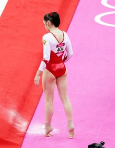 Aliya mustafina. every rhythmic gymnast walks like this it's cool to see an artistic gymnast do it.
