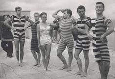 Men's swim and beach wear from Victorian and Edwardian eras with one model in a contemporary (1940s) swimsuit, ca. 1945-1950.