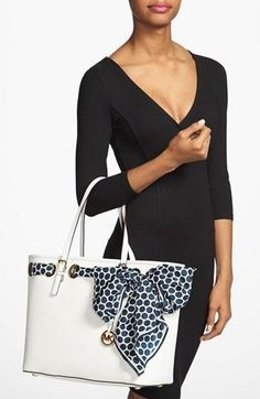 Adding a scarf to this tote brings a touch of glamour to this Michael Kors handbag.