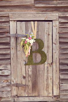 Moss monogram for barn door.